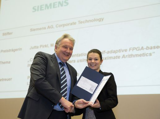 picture of Jutta Pirkl standing on stage receiving her Siemens Masterprize