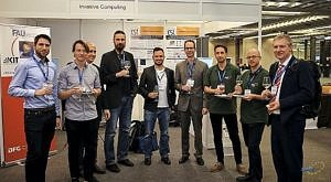 from right: J. Teich with team and M. Glaß (4th from left), University Ulm; all standing in front of the SFB/ESI booth