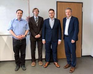 from the left: Prof. Wanka, Prof. Köstler, Chr. Schmitt, Prof. Teich standing and smiling
