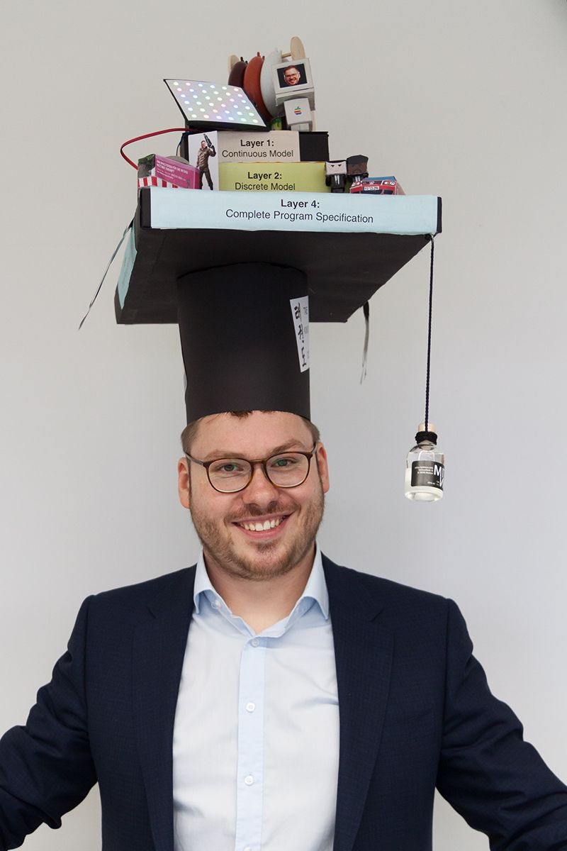 Picture of Christian Schmitt with his doctoral cap